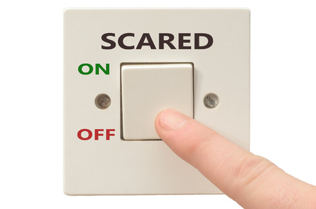 turning off: Turning off Scared with finger on electrical switch