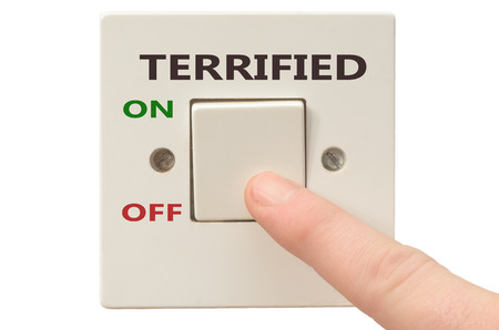 turning off: Turning off Terrified with finger on electrical switch Stock Photo
