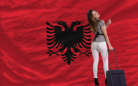 albanian: young beautiful woman is traveling to albania