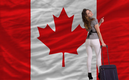 emigrant: young beautiful woman is traveling to canada