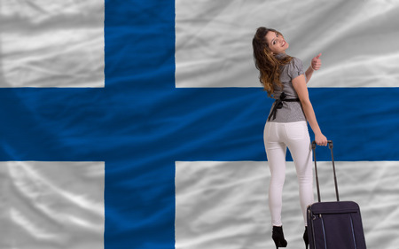 young beautiful woman is traveling to finland Stock Photo