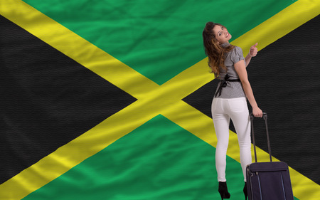 young beautiful woman is traveling to jamaica Imagens