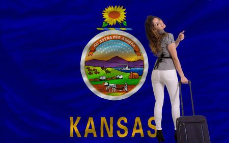 KANSAS: young beautiful woman is traveling to kansas