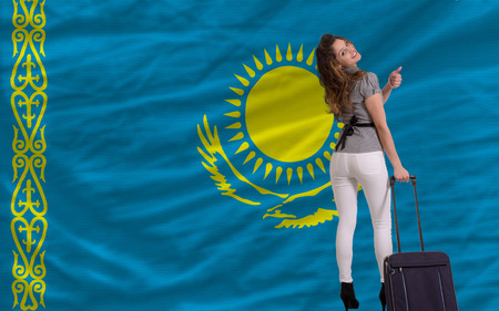 emigrant: young beautiful woman is traveling to kazakhstan
