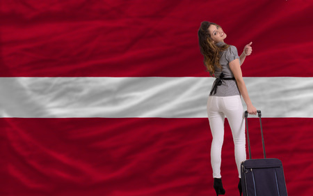 latvia girls: young beautiful woman is traveling to latvia