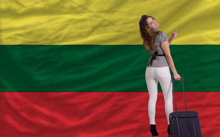lithuanian: young beautiful woman is traveling to lithuania