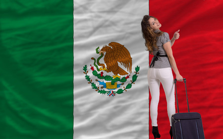 emigrant: young beautiful woman is traveling to mexico