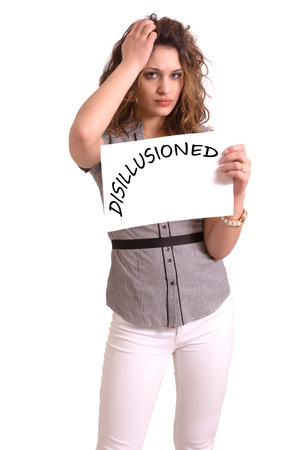 disillusioned: Young attractive woman holding paper with Disillusioned text on white background