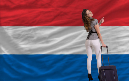 dutch girl: young beautiful woman is traveling to netherlands