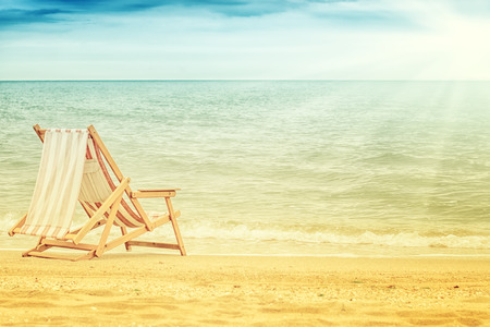 old vintage  chaise lounge on beautiful beach, summer  photo