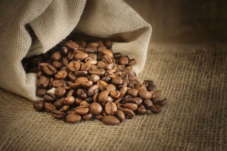 roasted coffee beans spill out of the bag
