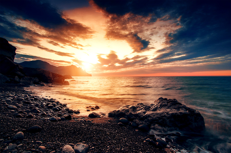 seascapes: beautiful sunset or sunrise on beach, natural summer background Stock Photo