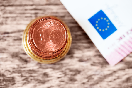 stack of european currency. closeup 1 euro cent. finance concept