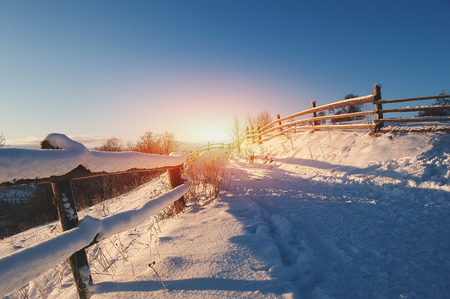 empty road covered with snow and frost. winter background