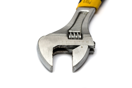 Wrench with a yellow handle on a white background, isolate