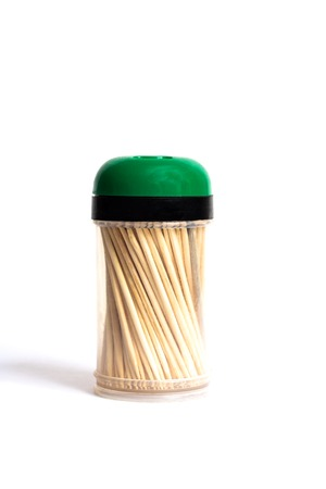 Wooden toothpicks in a plastic cup on a white background, isolate