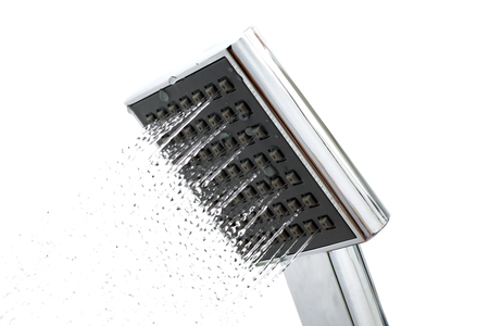 Shower head with water drops on a white background, isolated