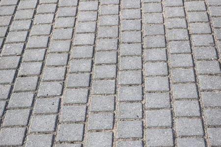 Concrete gray pavement slabs for floor or path close up, background or texture