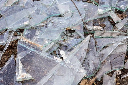 Broken glass shards close up, texture or background Imagens