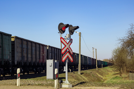 Traffic light and train on the railway close up