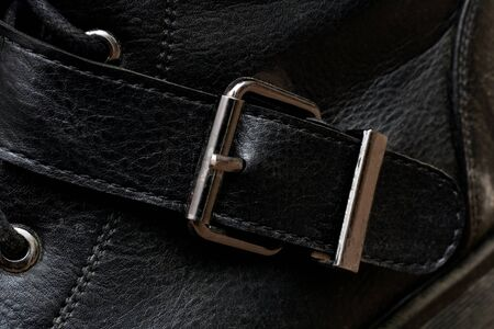 Buckle on a black shoe close up with copy space