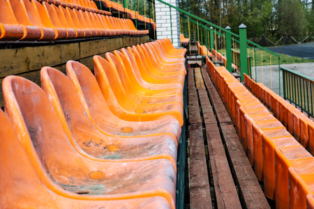 A lot of orange plastic seats close up 免版税图像
