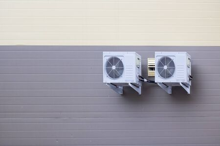 Air conditioners on the wall of the building from the outside Foto de archivo