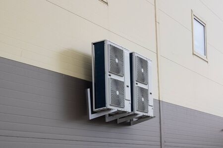 Air conditioners on the wall of the building from the outside Imagens