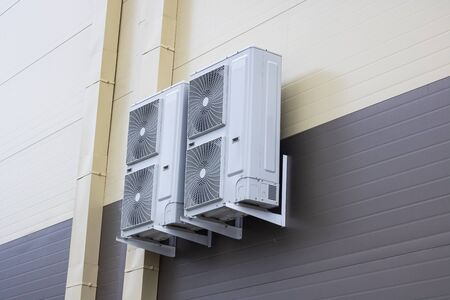 Air conditioners on the wall of the building from the outside Stock Photo