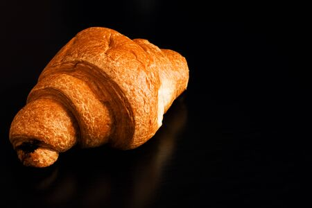 Croissant with chocolate on a black wooden table, copy space Archivio Fotografico - 131706001