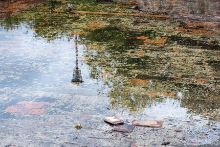 Background from a puddle on paving slabs close up Imagens