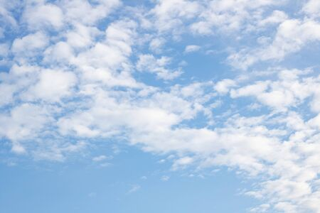 White clouds in the blue sky close up, background or texture
