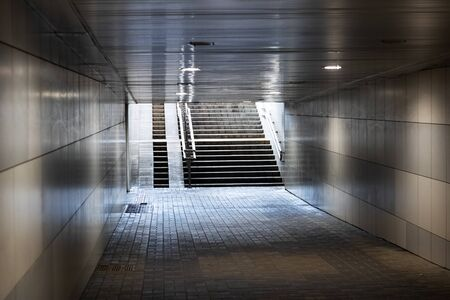 Exit the tunnel underpass and stairs in sunlight Archivio Fotografico
