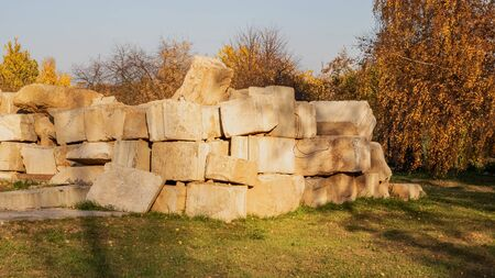Concrete blocks at a construction site close up in autumn