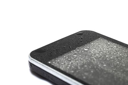 Drops of water on a phone display isolated on a white background