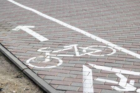 Marking a bike path on the sidewalk close up