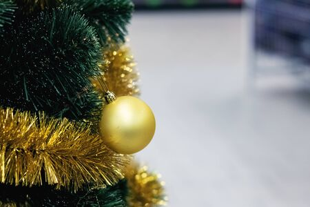 Yellow christmas ball on spruce close up, copy space 写真素材