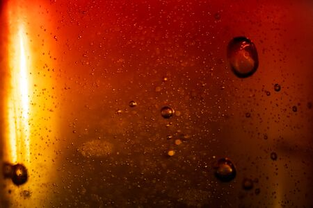 Bubbles in red water on a gray background