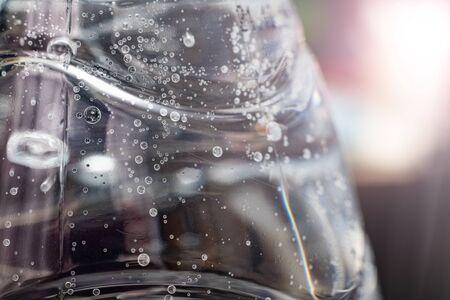 Bubbles in a water bottle in sunlight