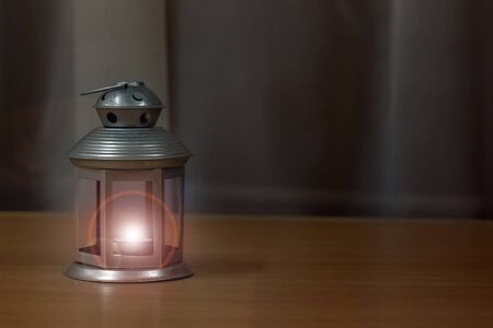Lantern with a candle in retro style, copy space 写真素材