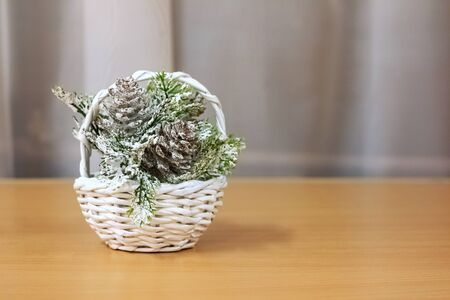 White basket with Christmas pine branches, copy space 写真素材