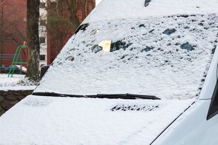 The first snow on a car windshield 写真素材