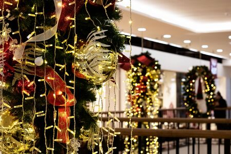 Balls and ribbons on Christmas tree, festive decoration