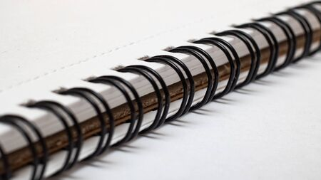 Spiral mount notebook on a white background close up
