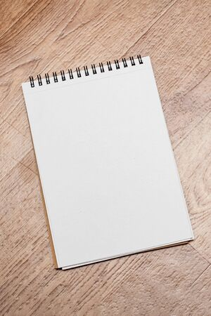 Notebook on a wooden table, copy space Banque d'images - 138555168