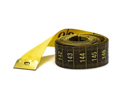Twisted measuring tape isolated on a white background