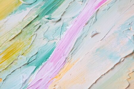 Smears of blue, pink, yellow and white paints on the wall 免版税图像