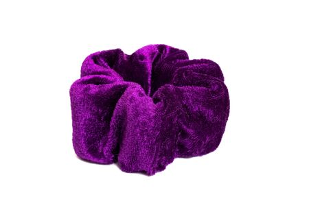 Big violet elastic band for hair isolated on a white background