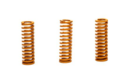 Three copper springs isolated on white background Standard-Bild