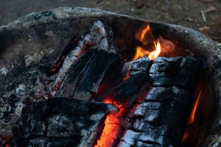 Coals of a bonfire in a basin in dark 스톡 콘텐츠